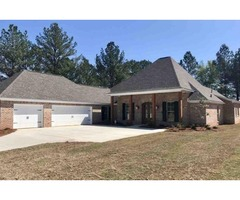 This 4 bedroom, 3 bath,3 car garage has all the curb appeal sitting on a large lot