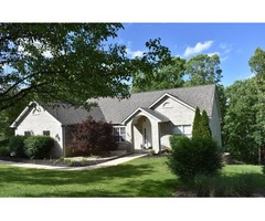 Custom built ranch residing on 2 partially wooded acres
