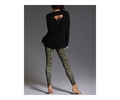 onzie hot yoga braid back top black