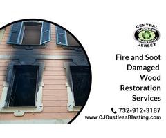 Dustless blasting for fire damaged wood restoration