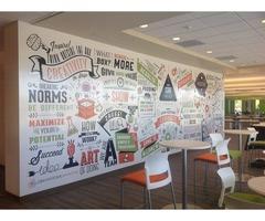 Vinyl wraps transform walls, windows, and vehicles into powerful marketing tools