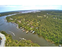 7.5 acres Prime Waterfront Acreage on Owens Creek!