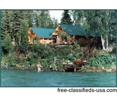 world class log cabin adventure lodge on the banks of the Kenai River
