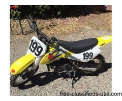 Suzuki yellow white and black motocross dirt bike