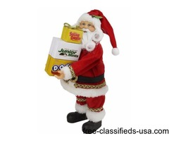 """12"""" Santa Claus Carrying Boxes of Dots, Junior Mints, and Sugar Daddy"""