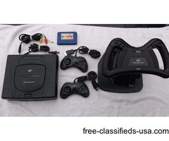 Sega Saturn w 2 Controllers, 8 Meg Cart, Steering Wheel & 14 Games