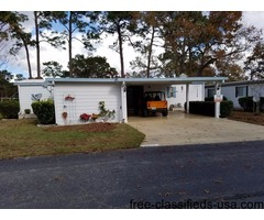 Manufactured home in premier golfing community