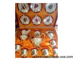 collectable dolls and tea set