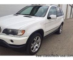 white BMW X5 2002