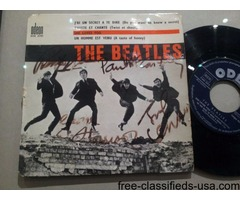 45T signed by all BEATLES in Paris 1964