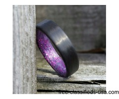 Carbon fiber unidirectional ring with purple sparkle inlay in a matte finish.