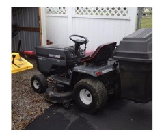 Sears riding lawn mower/with bagger and plow