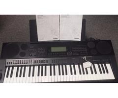 Casio CTK-7000 61-Key Portable Keyboard w/ Manual