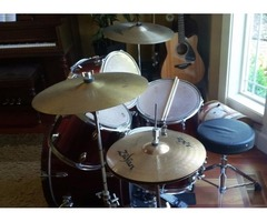 Drum set and a chair for sale
