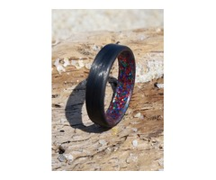Carbon fiber unidirectional ring with multi sparkle inlay in a matte finish.
