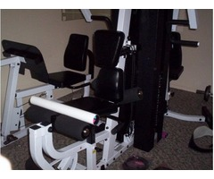 EXM 3000s BODY SOLID exercise machine w/ hundreds of pounds of free weights