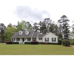 View this lovely 3 bedroom 2 bath country home nestled on 5.24 acres!