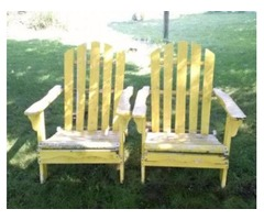 Two wooden lawn chairs