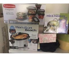 Still in the box crock pot, tupperware set, and mixing bowl set