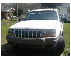 1999 Jeep Grand Cherokee white/gray with tan interior