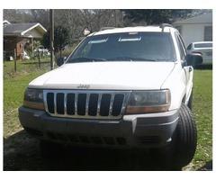 1999 Jeep Grand Cherokee white/gray with tan interior