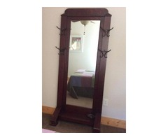 Antique mirror with hat/coat hooks