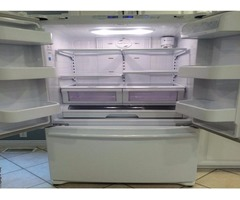White Samsug side by side refrigerator with bottom freezer