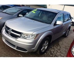 SILVER 2009 DODGE JOURNEY WITH THIRD ROW SEATING