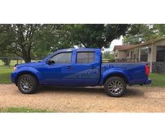 2012 Nissan Frontier, four door , tinted windows , 75,000 miles