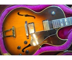 Gibson Guitar with Leather/Steel Reinforced Case
