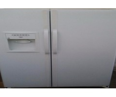 White ge side by side fridge with ice