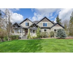 Gorgeous craftsman with grand floor-to-ceiling windows with views of lake